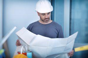 general contractor looking at the floor plan